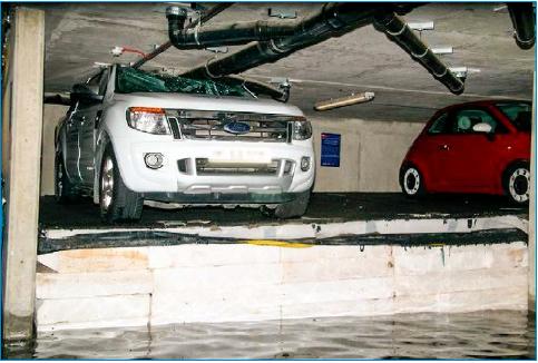 Rys. 4 Zniszczenia pojazdów na parkingu podziemnym [9]