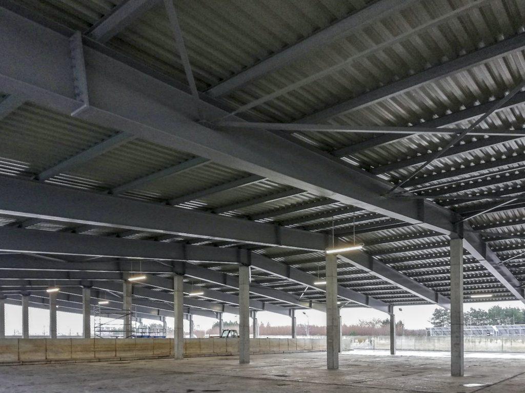 11. Budowa zadaszenia placu magazynowego osadu odwodnionego.